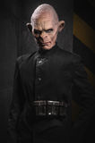 Angry baboonish man in black clothes Royalty Free Stock Images