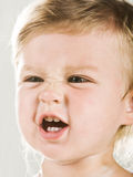 Angry baby. Portrtait of angry baby girl closeup Royalty Free Stock Photo
