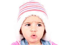 Angry baby. Baby with hat isolated on a white background Stock Image