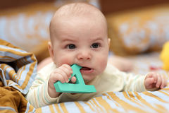 Angry baby with alphabet Stock Photo