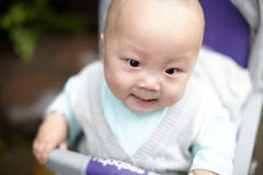 Angry baby. Boy in stroller Stock Images