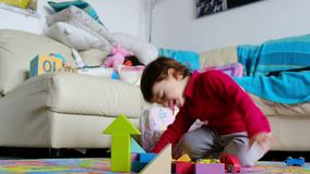 Angry baby fails at construction blocks game - reaction emotion management in childrens
