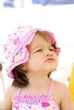 Angry baby girl at the beach. A little girl is looking worried or angry Royalty Free Stock Photos