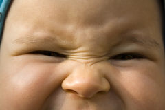Angry baby look Stock Photography