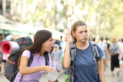 Angry backpackers arguing during vacation travel. In a big city street stock photos