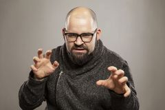 Angry bald man, gray background stock images