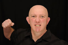 Angry Bald man Punching Royalty Free Stock Photo