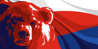 Angry bear against and Russian flag. Angry bear against the backdrop of the Russian flag Stock Photo