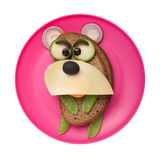 Angry bear made of bread and vegetables Stock Photos