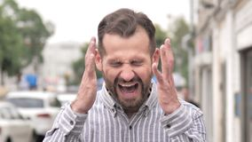 Angry beard casual man screaming outdoor. 4k high quality, 4k high quality stock video footage