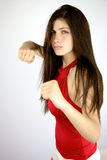 Angry beautiful girl ready to punch and get what she wants Stock Images