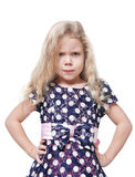 Angry beautiful little girl with blond hair  Stock Photos