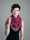 Angry beauty with colorful shawl scolding finger looking away Stock Images