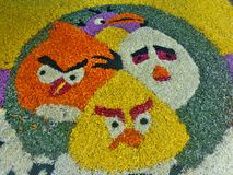 Angry birds flower rangoli. Kerala traditional Onam festival celebration flower design. Atham, Pookalam, Funny designs Royalty Free Stock Image