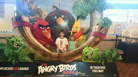 Angry Birds. Kids at movies with daddy Royalty Free Stock Image