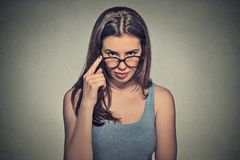 Angry bitchy serious woman with glasses skeptically looking at you. Headshot angry bitchy serious woman with glasses skeptically looking at you isolated on gray Stock Image