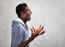 Angry black man face. Angry fury african american man portrait. People face expressions Stock Photos