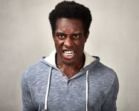 Angry black man. Angry fury african american man portrait. People face expressions royalty free stock image