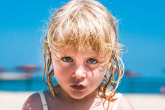 Angry blond baby girl. Close up of an angry blond baby girl Stock Photography
