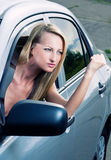 Angry blond driver. Angry blond young woman sitting in a car Royalty Free Stock Photography