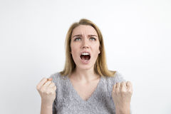 Angry blond woman screaming stock photography