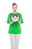 Angry blonde activist shouting in megaphone Stock Photos