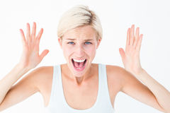 Angry blonde screaming with hands up Royalty Free Stock Images