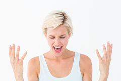 Angry blonde yelling with hands up Royalty Free Stock Images