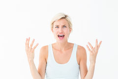 Angry blonde yelling with hands up Royalty Free Stock Photo