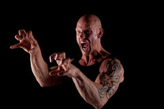 Angry Bodybuilder. Angry Fit Bodybuilder Screaming On Black Background Stock Images
