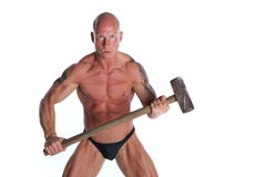 Angry Bodybuilder With Hammer. Angry Fit Bodybuilder With Hammer On White Isolated Background Stock Image