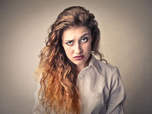 Angry bored woman. Young woman with a bored expression stock photography