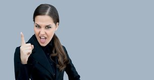 Angry boss. Young executive making a point, isolated, clipping path, with copy space stock photos