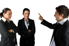 Angry boss. Businessman screaming and pointing to his colleagues businesswoman who listen him shocked,check also Royalty Free Stock Images