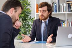 Angry boss arguing with an employee after a mistake royalty free stock images