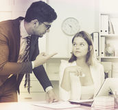 Angry boss blowing up female Royalty Free Stock Photo