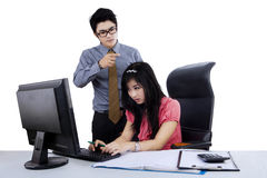 Angry boss bullying a woman. Angry boss bullying a beautiful businesswoman isolated over white Stock Images