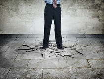 Angry boss with cracking floor. Angry boss step on a cracking floor means angry Royalty Free Stock Image