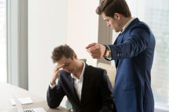Angry boss dismissing frustrated upset subordinate, getting fire. Angry boss dismissing frustrated upset male subordinate, dissatisfied employer telling employee Stock Image