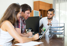 Angry boss with employees in the office Royalty Free Stock Photo