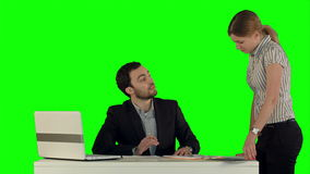 Angry boss with female worker in office on a Green. Screen, Chroma Key. Professional shot on BMCC RAW with high dynamic range. You can use it e.g in your stock video footage
