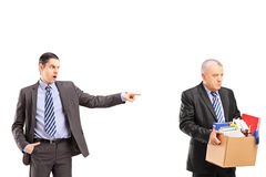 Angry boss firing an employee. Isolated on white background Royalty Free Stock Photos