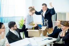 Angry boss firing. An angry boss is firing his employee Stock Photos