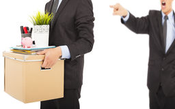 An angry boss firing a man and carrying belongings. Over white Stock Images
