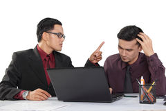 Angry boss and his confused employee Royalty Free Stock Photo