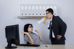 Angry boss at his employee in the office Royalty Free Stock Images