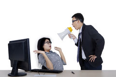 Angry boss at his employee on studio Royalty Free Stock Image