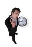Angry boss holding clock Royalty Free Stock Photography