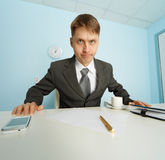 Angry boss looks at slave Stock Photo