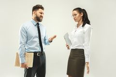 Angry boss. Man and his secretary standing at office or studio. Business men with his colleague. Female and male caucasian models. Office relationships concept Stock Photography